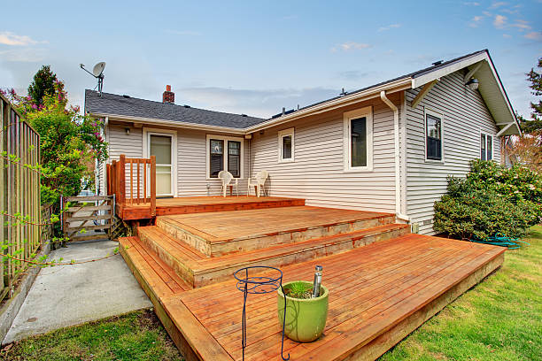 Picture of Large wooden back deck with two chairs. - Photo