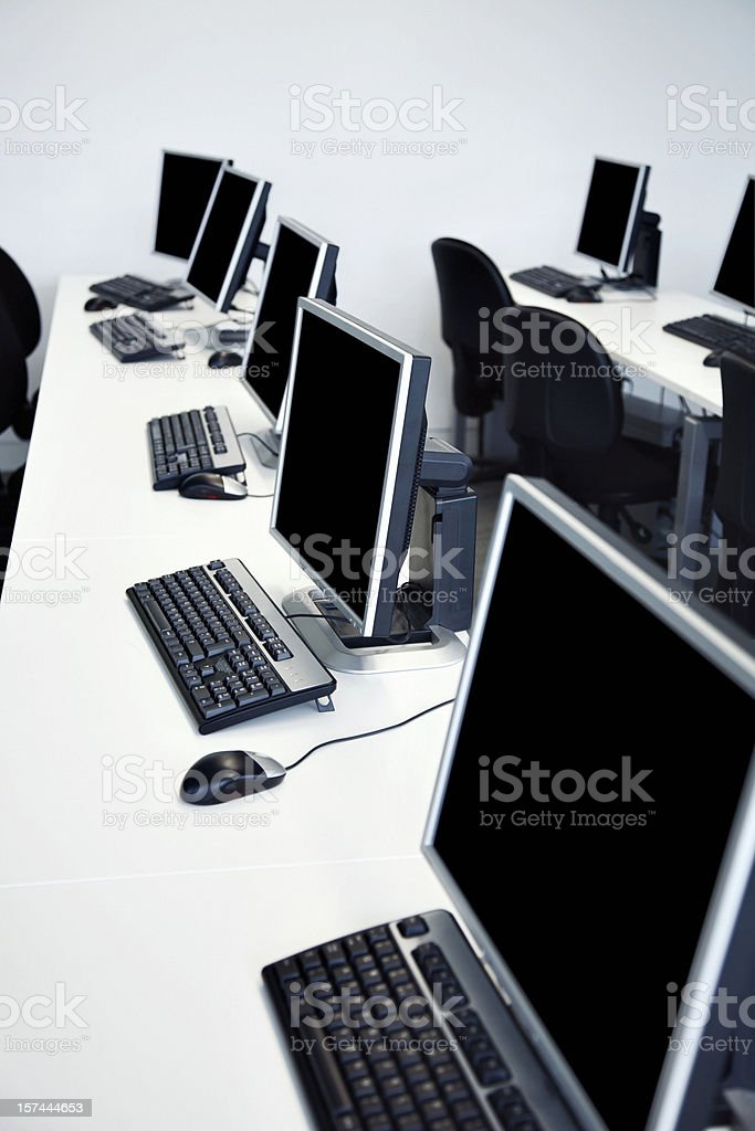A Picture Of Long White Desks With Black Computers Stock Photo Download Image Now Istock