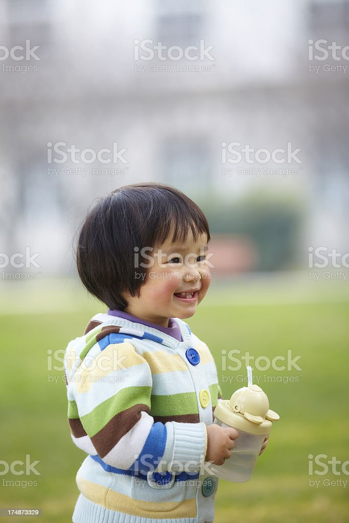 picture of lovely baby girl outdoor in the park royalty-free stock photo