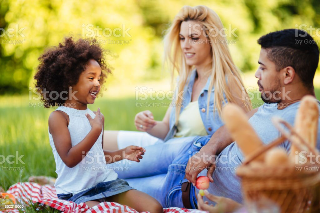 Picture of lovely couple with their daughter having picnic royalty-free stock photo
