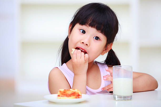 picture of lovely kid eating stock photo