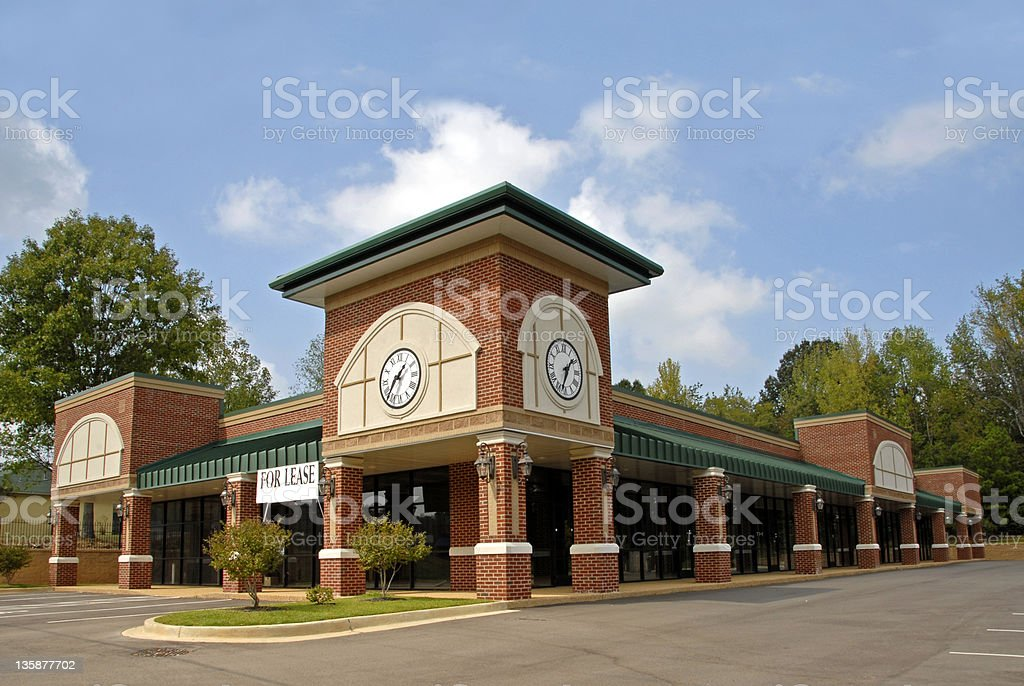 Picture of new commercial property with a for lease sign royalty-free stock photo