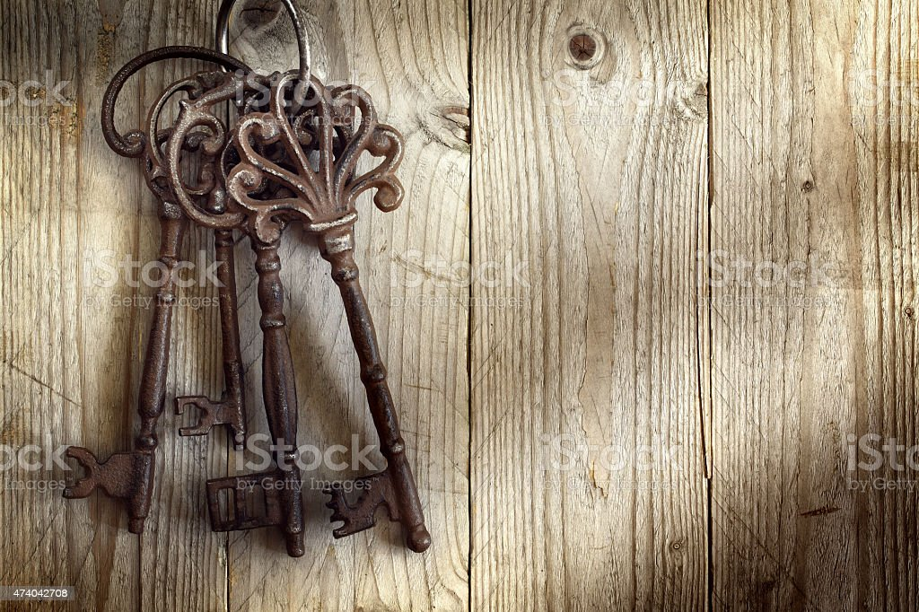A picture of old skeleton keys hanging on a wall stock photo
