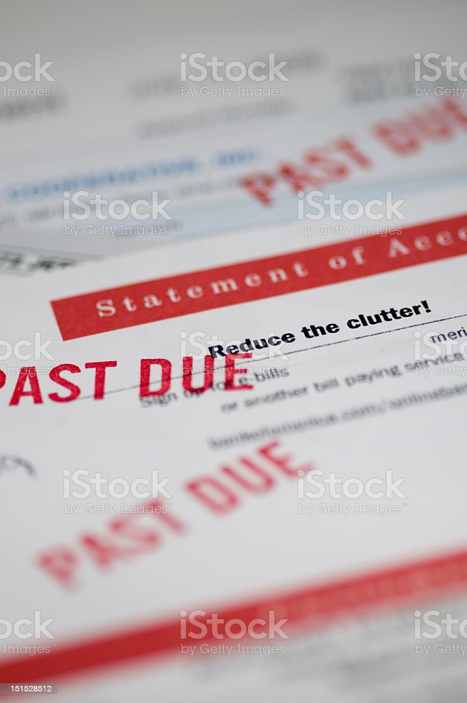 A picture of past due bills with red stamps stock photo