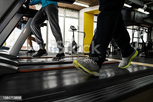 879180126istockphoto Picture of people running on treadmill in gym 1084713858
