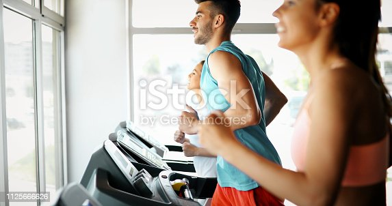 879180126 istock photo Picture of people running on treadmill in gym 1125666626