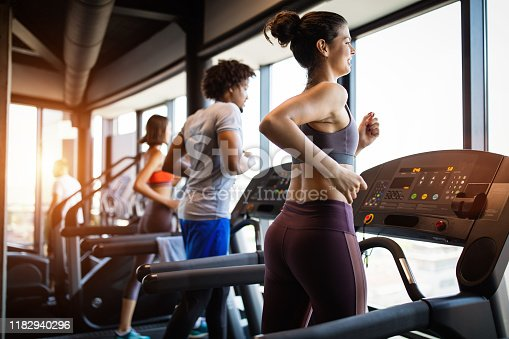Picture of fit people running on treadmill in gym