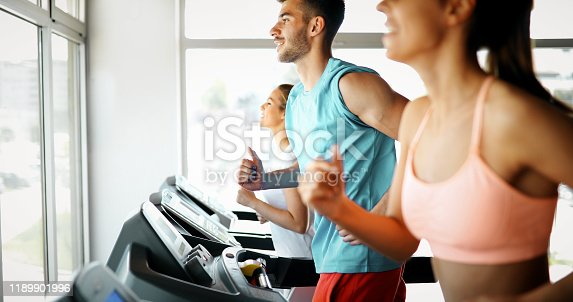 879180126 istock photo Picture of people running on treadmill in gym 1189901996