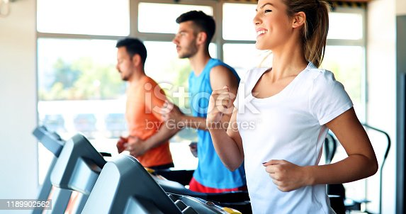 879180126 istock photo Picture of people running on treadmill in gym 1189902562