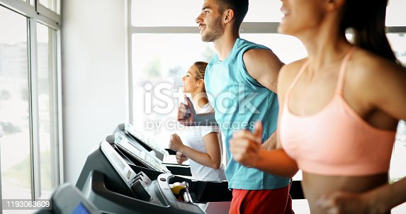 879180126 istock photo Picture of people running on treadmill in gym 1193063609