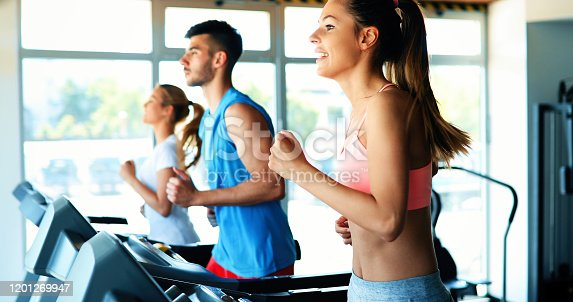 879180126 istock photo Picture of people running on treadmill in gym 1201269947