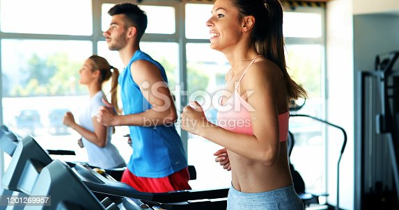879180126 istock photo Picture of people running on treadmill in gym 1201269957