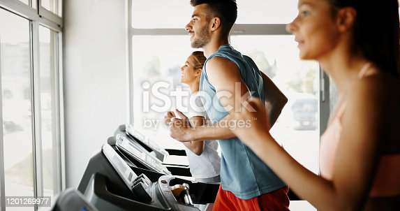 879180126 istock photo Picture of people running on treadmill in gym 1201269977