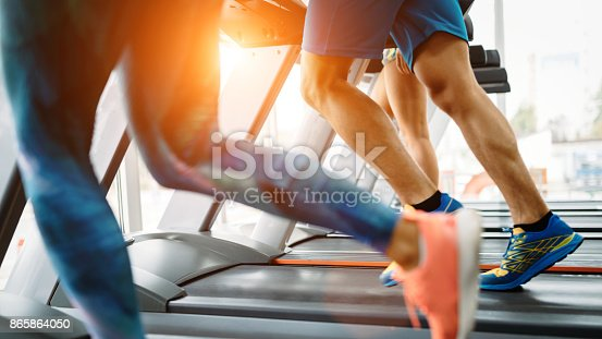 879180126istockphoto Picture of people running on treadmill in gym 865864050
