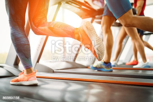 879180126istockphoto Picture of people running on treadmill in gym 865864158