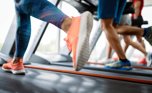 Picture of people running on treadmill in gym Picture of people doing cardio training on treadmill in gym treadmill stock pictures, royalty-free photos & images