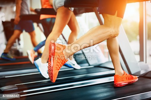 879180126istockphoto Picture of people running on treadmill in gym 875568342