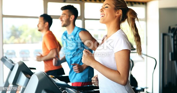 879180126 istock photo Picture of people running on treadmill in gym 879177012