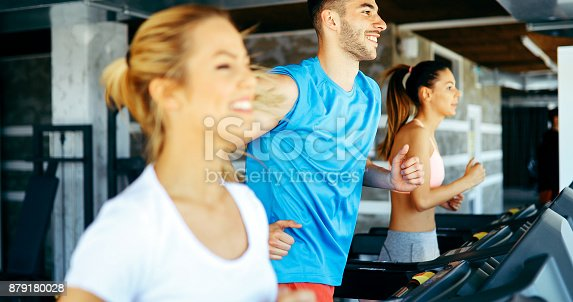 879180126istockphoto Picture of people running on treadmill in gym 879180028