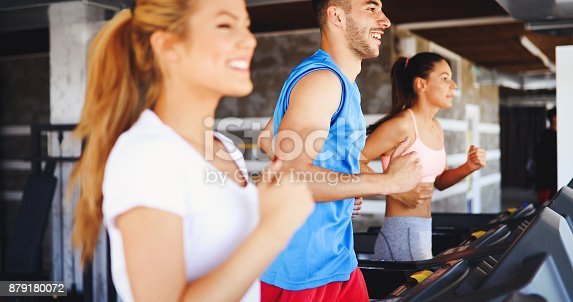 879180126istockphoto Picture of people running on treadmill in gym 879180072