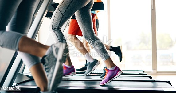 879180126istockphoto Picture of people running on treadmill in gym 879180126