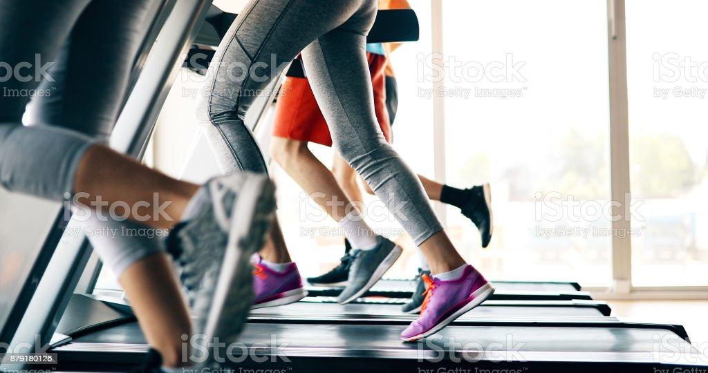 Picture of people running on treadmill in gym stock photo