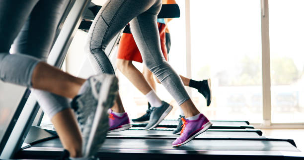 picture of people running on treadmill in gym - health and beauty stock photos and pictures