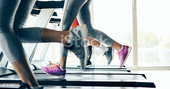 879180126istockphoto Picture of people running on treadmill in gym 879180214
