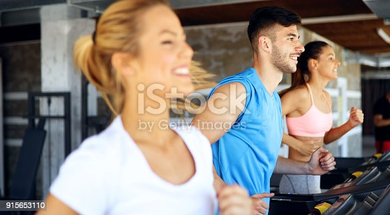 879180126istockphoto Picture of people running on treadmill in gym 915653110