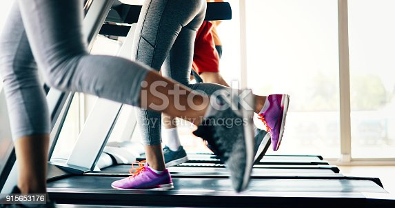 879180126istockphoto Picture of people running on treadmill in gym 915653176
