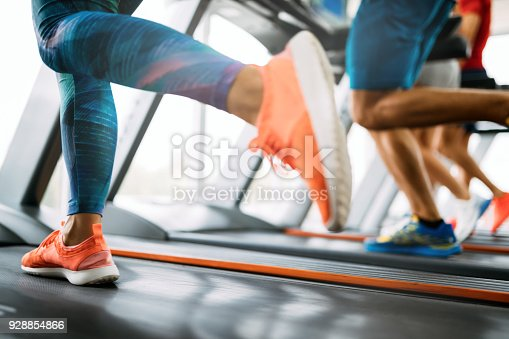 879180126istockphoto Picture of people running on treadmill in gym 928854866