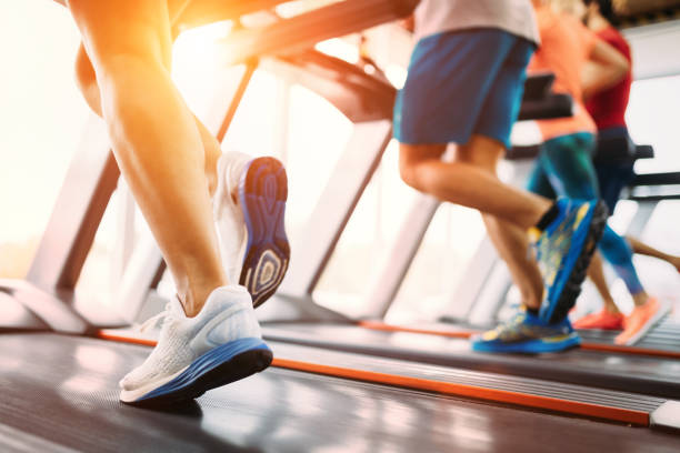 Picture of people running on treadmill in gym Picture of people doing cardio training on treadmill in gym cardiovascular exercise stock pictures, royalty-free photos & images