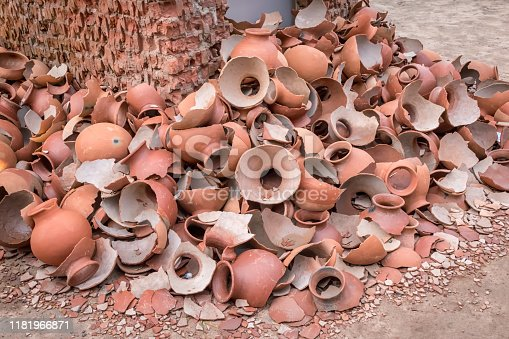 106415613istockphoto Picture of pile of broken Clay Pottery or Earthenware or traditional Jar on abandoned hut 1181966871