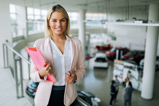 istock Picture of professional salesperson working in car dealership 1073743146