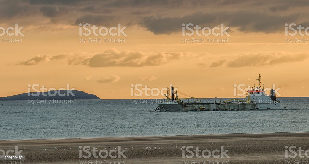 picture of sand boat on coastline stock photo