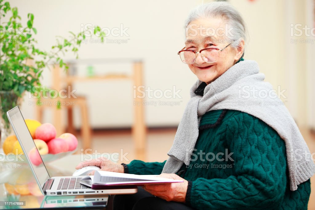 picture of senior asian woman using laptop stock photo