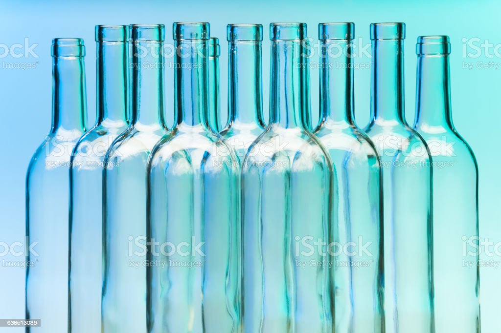Picture of several clear glass wine bottles stock photo