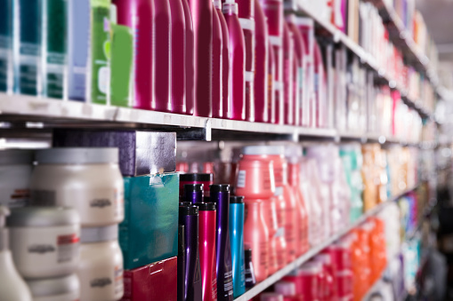 istock Picture of showcase with bottles of shampoos and conditioners 1074797524