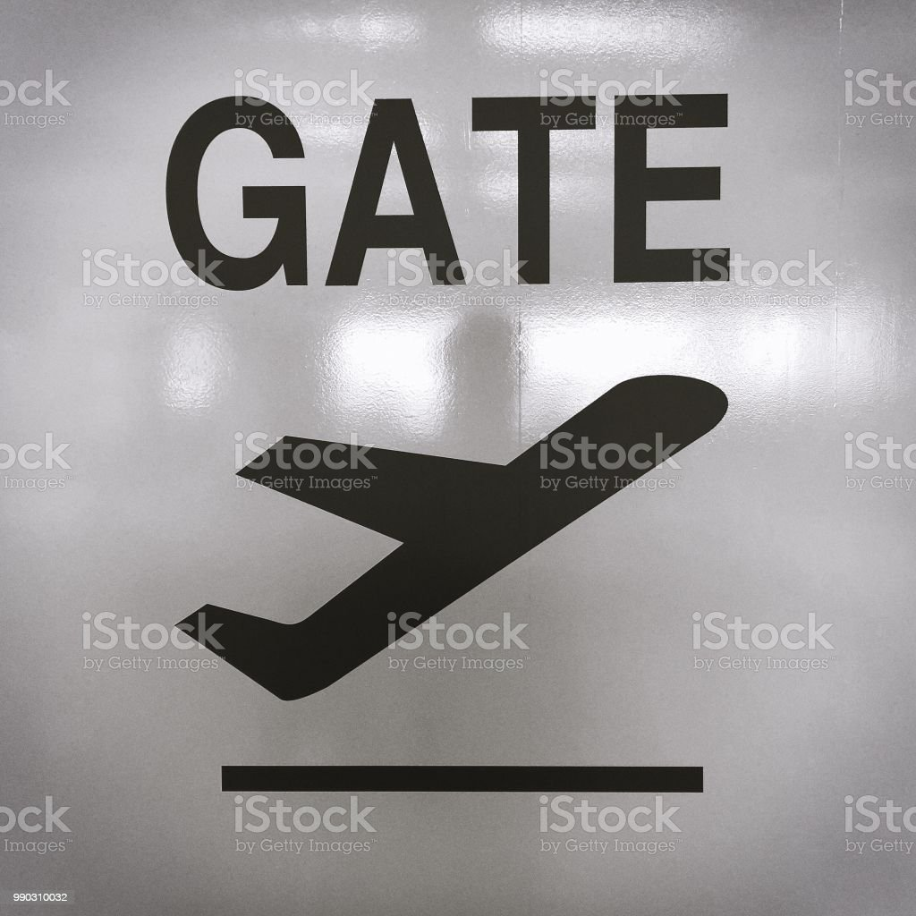 Picture of sign with an airplane taking off for the direction of the departure terminal at an airport stock photo