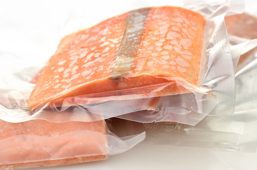 frozen salmon fillet in vacuum packages close up