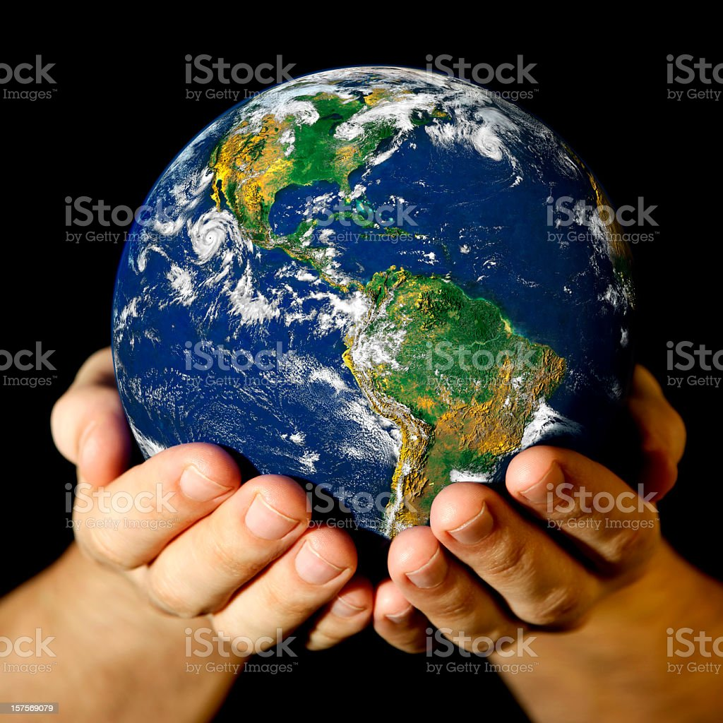 A picture of someone holding a mini world in their hands Earth globe (America view) in hands, isolated on black. Black Color Stock Photo