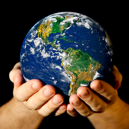 A Picture Of Someone Holding A Mini World In Their Hands Stock Photo - Download Image Now