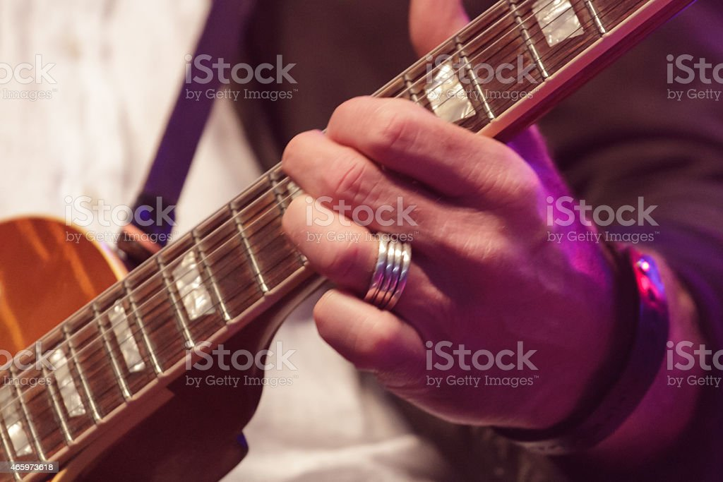 A picture of someone playing a guitar stock photo
