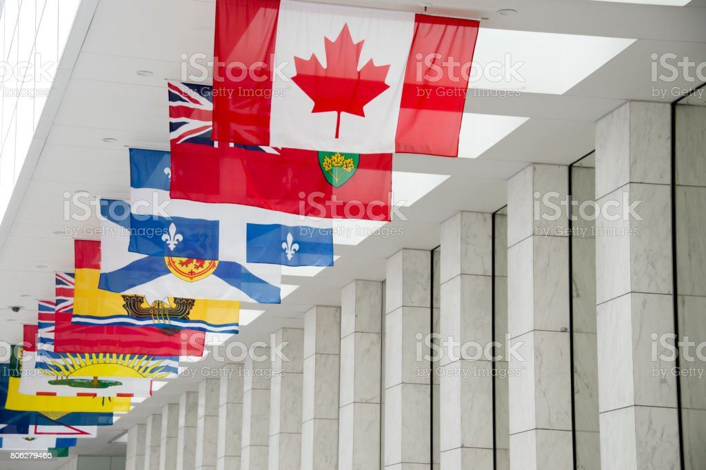Picture of the canadian Flag along with the flags of the 10 Canadian Provinces and the 3 Canadian Territories in Toronto, Canada stock photo