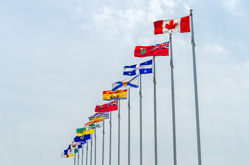 Picture of the canadian Flag along with the flags of the 10 Canadian Provinces and the 3 Canadian Territories, in Ottawa, Canada