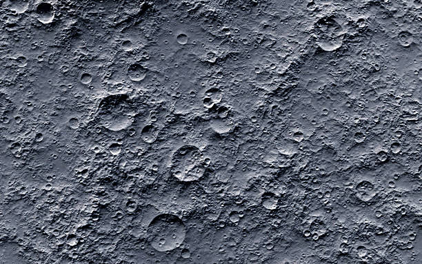 A picture of the moons surface that contains craters stock photo
