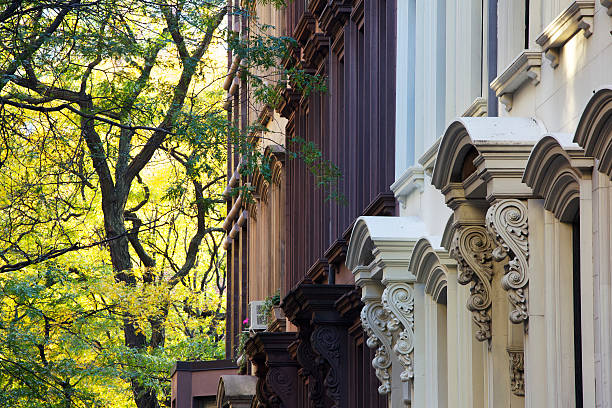 A picture of the tops of New York Brownstones stock photo