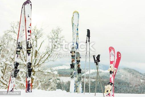 Picture of three pairs of skis of skiers family on the chair lift