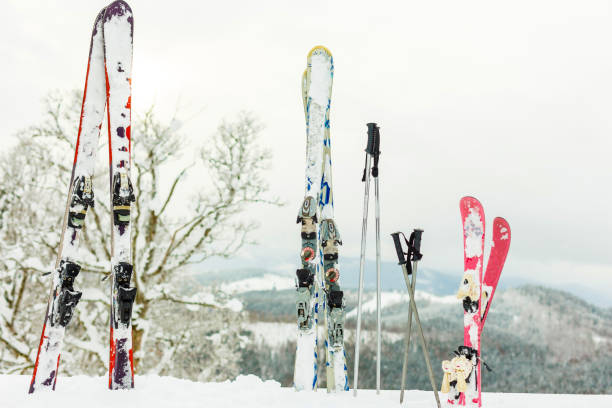 Picture of three pairs of skis of skiers family on the chair lift stock photo