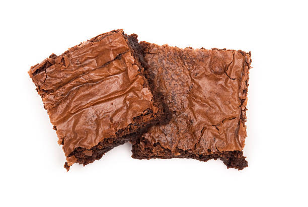 A picture of two brownies on a white background stock photo